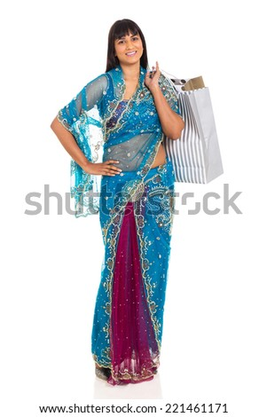 indian woman in saree carrying shopping bags on white background - stock photo