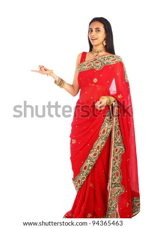 Indian woman in traditional clothing presenting.