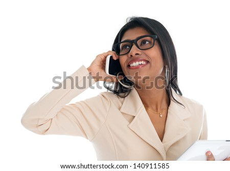Indian woman on the phone. Smart Indian business woman talking on the phone smiling happy isolated on white background. Beautiful Asian female model. - stock photo