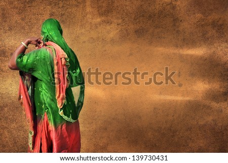 Indian woman on vivid parchment texture aged background - stock photo