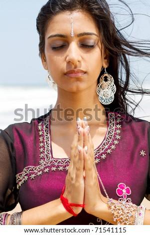 indian woman praying - stock photo