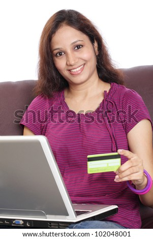 Indian woman shopping online from home - stock photo