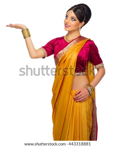 Indian woman shows welcome gesture isolated - stock photo