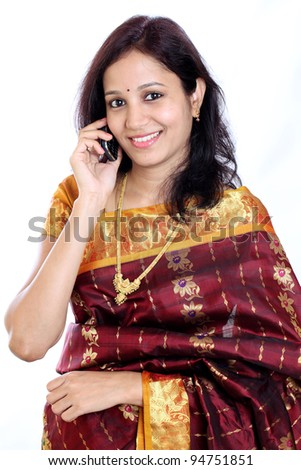 Indian woman talking on cellphone - stock photo