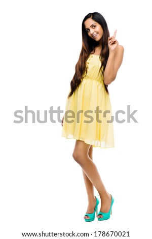 Indian woman thinking on white background - stock photo