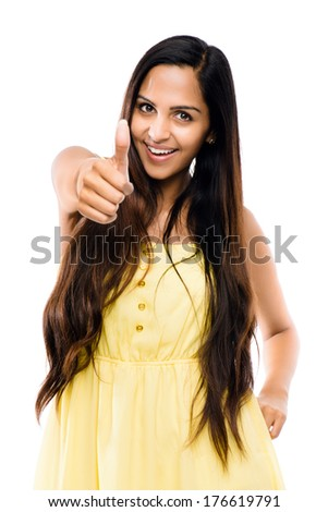 Indian woman thumbs up white background - stock photo