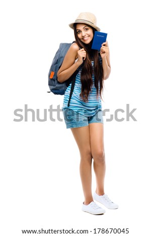 Indian woman tourist traveler holding passport excited for travel - stock photo