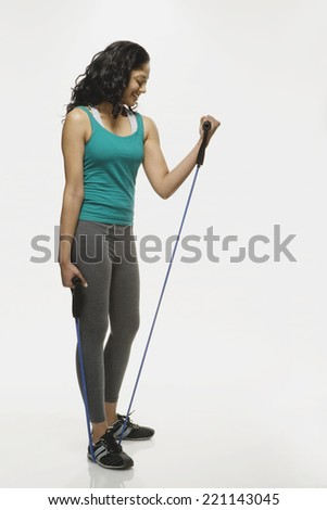 Indian woman using exercise band
