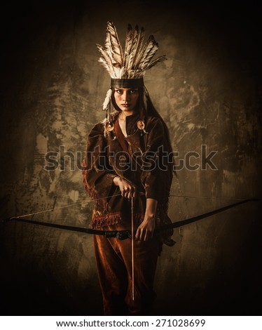Indian woman warrior with bow  - stock photo
