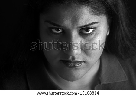 Indian woman with angry or annoyed expression