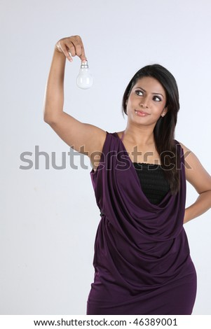 indian woman with bulb - stock photo