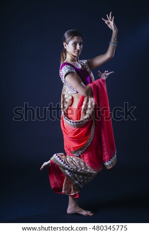 indian woman with leg up in a sari