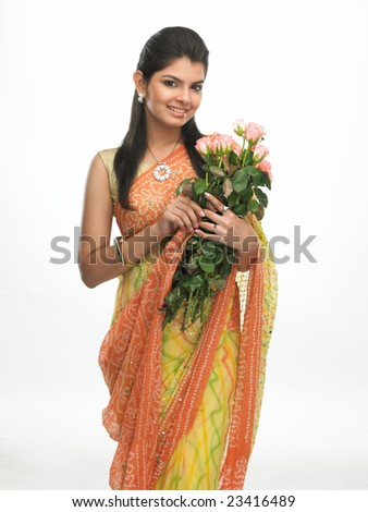 Indian woman with sari holding bunch of pink roses