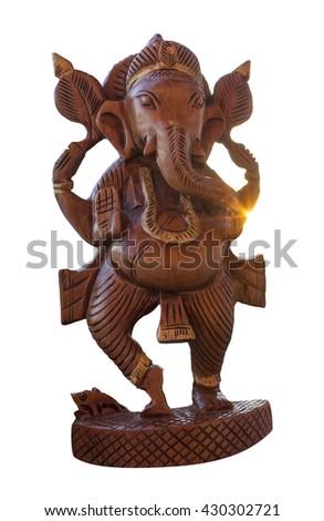 indian wooden  ganesha god figurine, isolated, sunbeams - stock photo