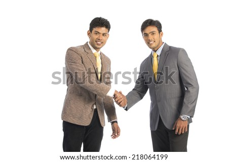 Indian young business people shaking hands on white.  - stock photo