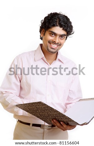 Indian young businessman posing with document on white.