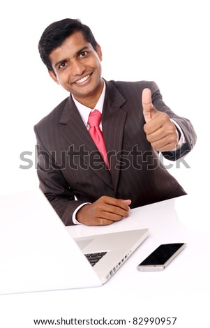 Indian young businessman posing with laptop isolated on white.