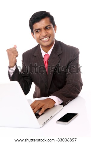 Indian young businessman posing with laptop isolated on white. - stock photo