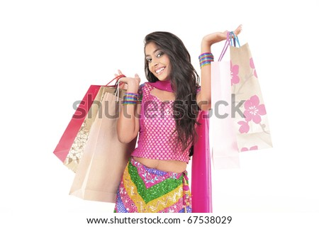 Indian Young girl wearing ethnic Holding Shopping Bags