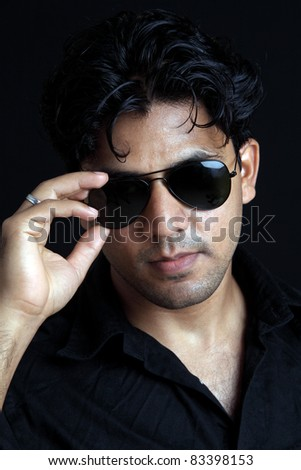 Indian young man posing to the camera.