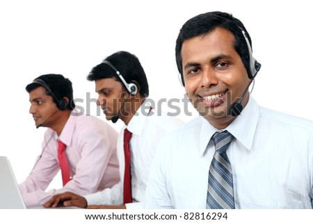 Indian young people working in call center isolated on white.