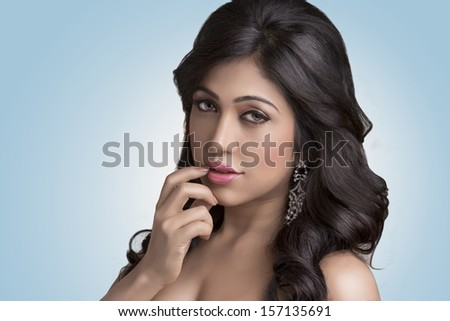 Indian young pretty girl beauty shot in studio light. - stock photo