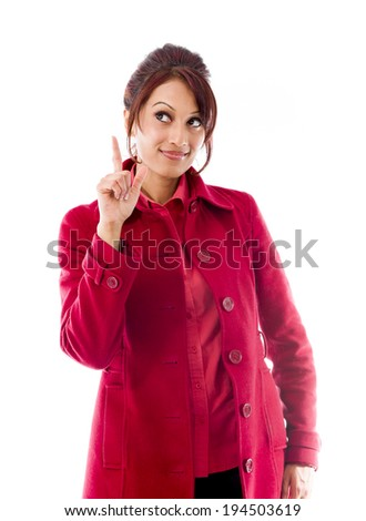 Indian young woman pointing finger upward - stock photo