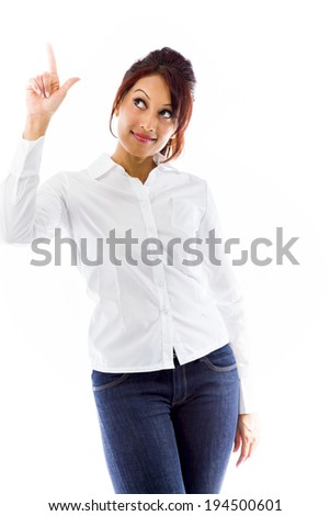Indian young woman pointing upwards - stock photo