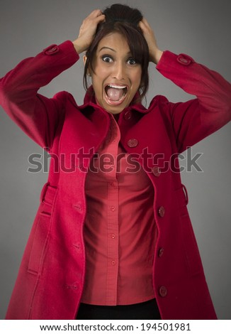 Indian young woman pulling her hair and screaming in frustration - stock photo