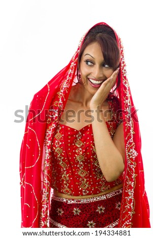 Indian young woman whispering message isolated on white background - stock photo