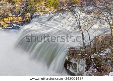 Indiana's Mill Creek, swollen with melt water, rages over Upper Cataract Falls, a waterfall in Lieber State Recreation Area. - stock photo