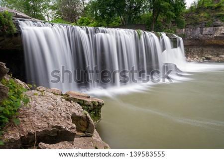 Indiana's Upper Cataract Falls pours over limestone ledges. - stock photo