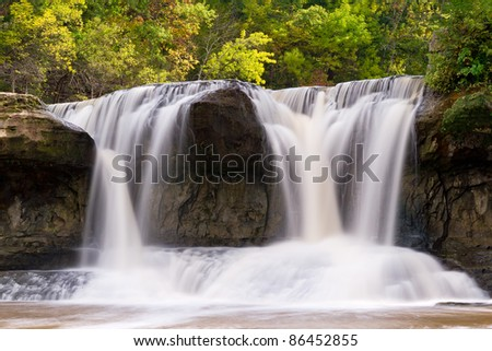 Indiana's Upper Cataract Falls (right side only) pouring through large boulders. - stock photo