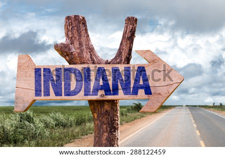 Indiana wooden sign with road background - stock photo