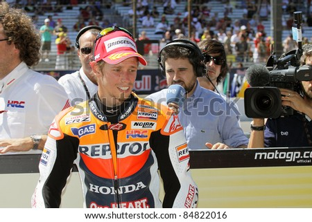 INDIANAPOLIS - AUGUST 28: Australian Honda rider Casey Stoner arrives  at the  2011 Red Bull MotoGP of Indianapolis on August 28, 2011 in Indianapolis, Indiana. - stock photo
