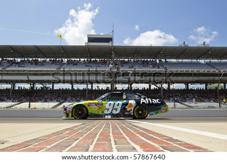 INDIANAPOLIS, IN - JULY 23:  Carl Edwards brings his Aflac Ford Fusion down pit road for the Brickyard 400 race at the Indianapolis Motor Speedway on July 23, 2010 in Indianapolis, IN. - stock photo