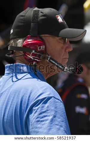 INDIANAPOLIS, IN - JULY 25:  Coach Joe Gibbs watches his race teams during the Brickyard 400 race at the Indianapolis Motor Speedway on July 25, 2010 in Indianapolis, IN. - stock photo