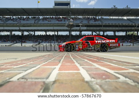 INDIANAPOLIS, IN - JULY 23:  Jamie McMurray brings his Bass Pro Shops Chevrolet down pit road for the Brickyard 400 race at the Indianapolis Motor Speedway on July 23, 2010 in Indianapolis, IN. - stock photo
