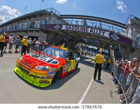 INDIANAPOLIS, IN - JULY 24:  Jeff Gordon brings his Chevrolet back into the garage area for the Brickyard 400 race at the Indianapolis Motor Speedway on July 24, 2010 in Indianapolis, IN. - stock photo