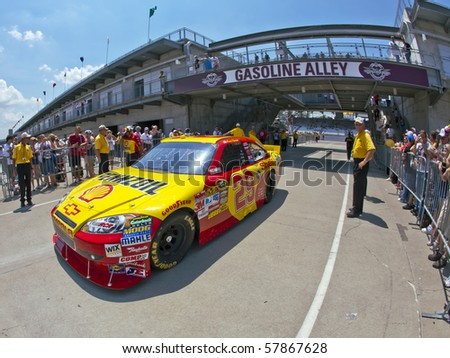 INDIANAPOLIS, IN - JULY 24:  Kevin Harvick brings his Shell Chevy back into the garage area for the Brickyard 400 race at the Indianapolis Motor Speedway on July 24, 2010 in Indianapolis, IN. - stock photo
