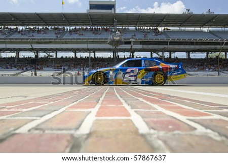 INDIANAPOLIS, IN - JULY 23:  Kurt Busch brings his Miller Lite Dodge down pit road for the Brickyard 400 race at the Indianapolis Motor Speedway on July 23, 2010 in Indianapolis, IN. - stock photo
