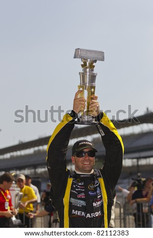 INDIANAPOLIS, IN - JULY 31:  Paul Menard (27) plays the fuel game perfectly, winning the 18th annual Brickyard 400 race at the Indianapolis Motor Speedway in Indianapolis, IN on Jul 31, 2011. - stock photo