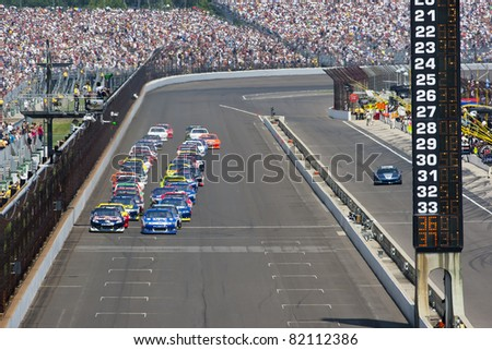 INDIANAPOLIS, IN - JULY 31: The NASCAR Sprint Cup Series teams take to the track for the 18th annual Brickyard 400 race at the Indianapolis Motor Speedway in Indianapolis, IN on Jul 31, 2011. - stock photo