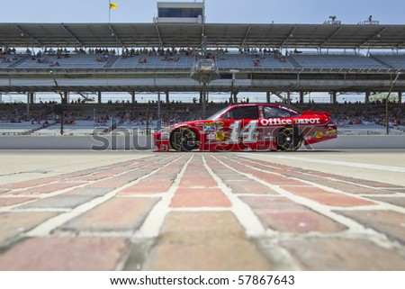 INDIANAPOLIS, IN - JULY 23:  Tony Stewart brings his Old Spice Chevrolet down pit road for the Brickyard 400 race at the Indianapolis Motor Speedway on July 23, 2010 in Indianapolis, IN. - stock photo