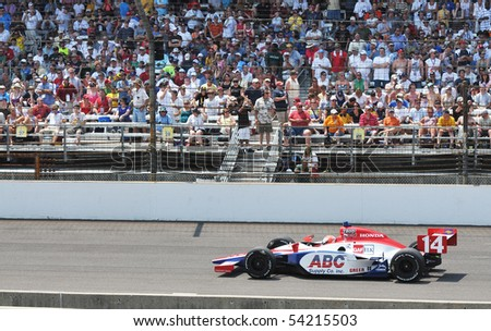 INDIANAPOLIS, IN - MAY 30: Indy car driver vitor meira is running in the Indy 500 race May 30, 2010 in Indianapolis, IN - stock photo