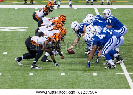 INDIANAPOLIS, IN - SEPT 2: Bengals and Colts line-up during football game between Indianapolis Colts and Cincinnati Bengals on September 2, 2010 in Indianapolis, IN - stock photo