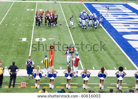 INDIANAPOLIS, IN - SEPT 2: Indianapolis Colt and Cincinnati Bengals huddle during the football game on September 2, 2010 in Indianapolis, IN - stock photo