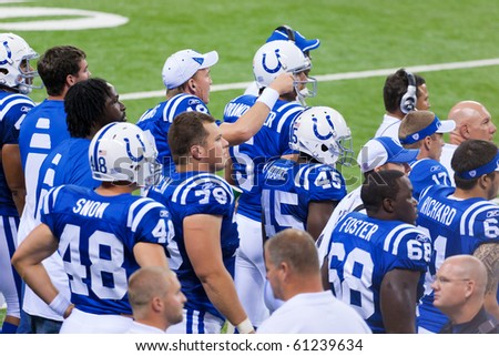 INDIANAPOLIS, IN - SEPT 2: Peyton Manning and his teammates watch the game between Indianapolis Colts and Cincinnati Bengals on September 2, 2010 in Indianapolis, IN - stock photo