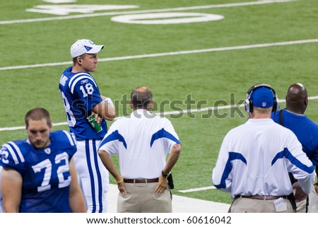 INDIANAPOLIS, IN - SEPT 2: Peyton Manning, Indianapolis Colts quarterback watches the game between Indianapolis Colts and Cincinnati Bengals on September 2, 2010 in Indianapolis, IN - stock photo