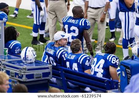 INDIANAPOLIS, IN - SEPT 2: Peyton Manning, Indianapolis Colts quarterback, watches the game between Indianapolis Colts and Cincinnati Bengals on September 2, 2010 in Indianapolis, IN - stock photo